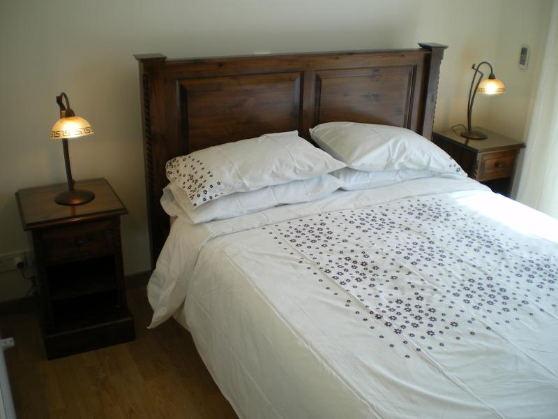 Bedroom 4 - Double bed, air con with patio doors overlooking swimming pool