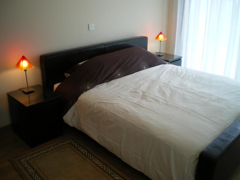 Bedroom 6 - Super King size bed in ensuite bedroom, air con, patio doors overlooking swimming pool.