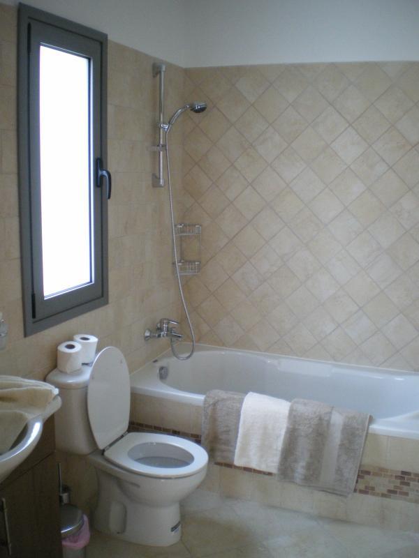 Bedroom 6 - Ensuite bathroom with washbasin, bath & shower
