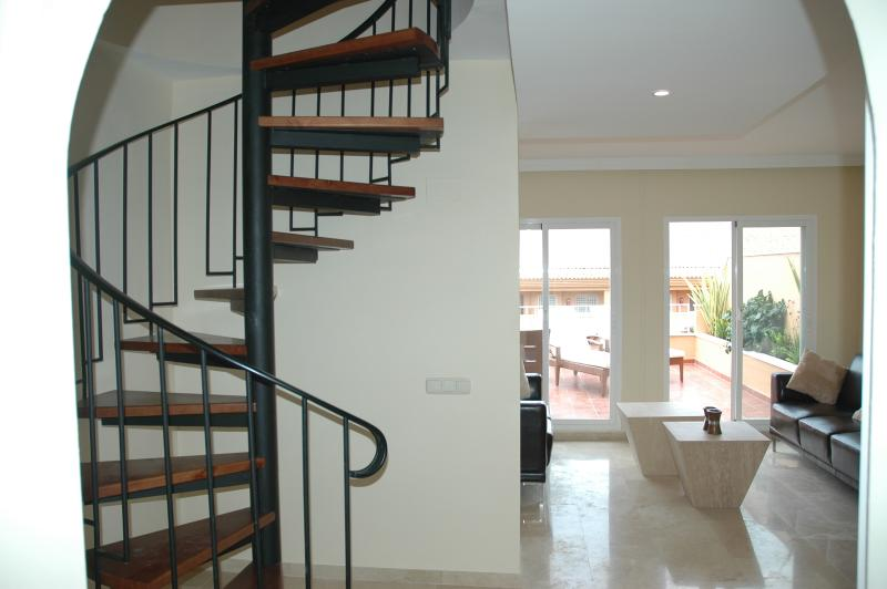 Spiral staircase leading to the master bedroom & upper terrace