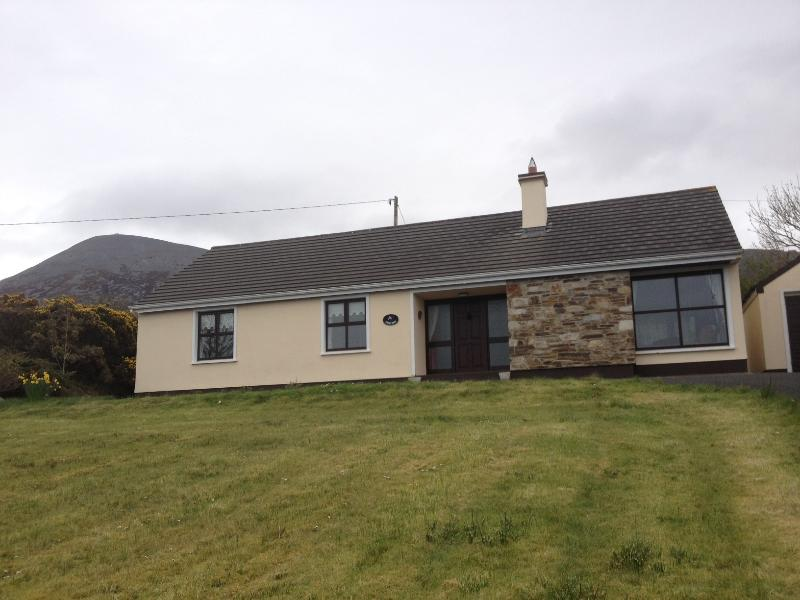 Frontal view of house with Croagh Patrick in background.