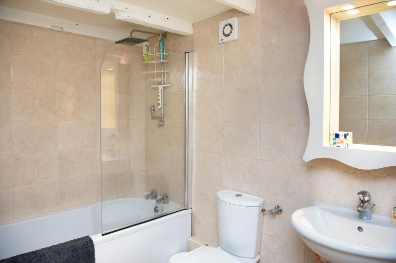Bath with fixed overhead shower