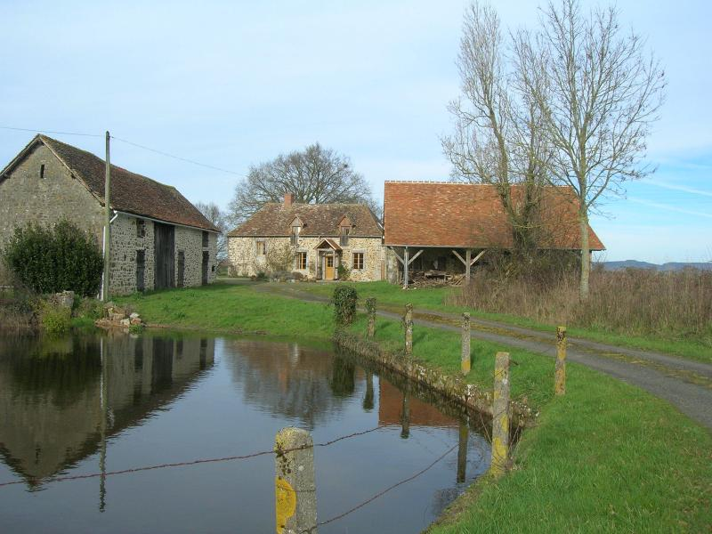 House, outbuildings and pond