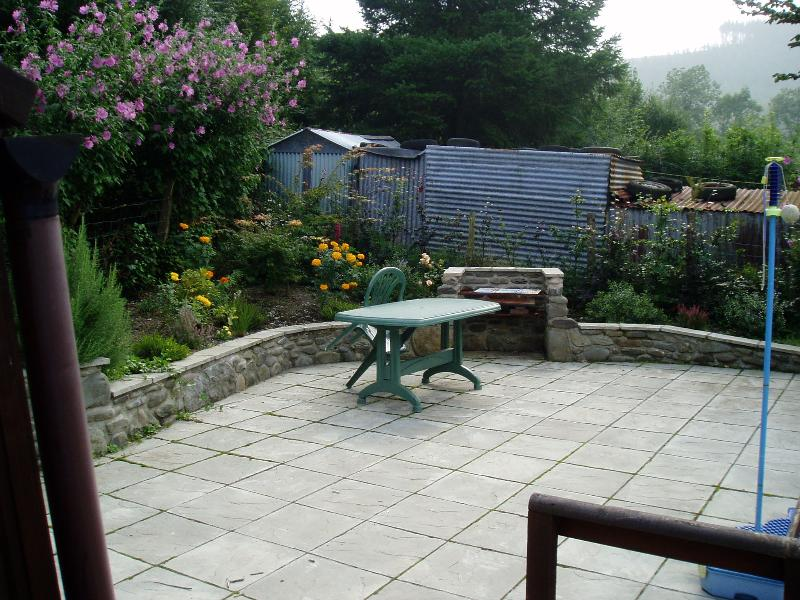 top terrace and BBQ level with garden and beech hedge