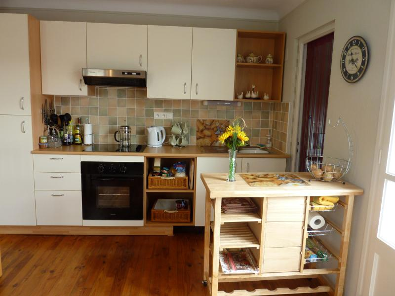 Spacious Kitchen with adjacent utility room with dish washer and washing machine