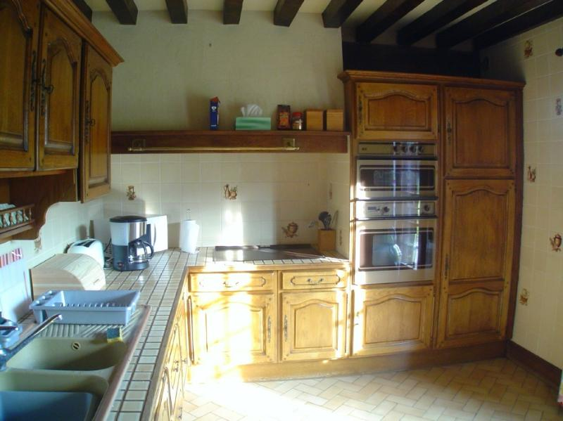 Kitchen with 5 stoves, oven, microwave, d/w, w/m & dryer
