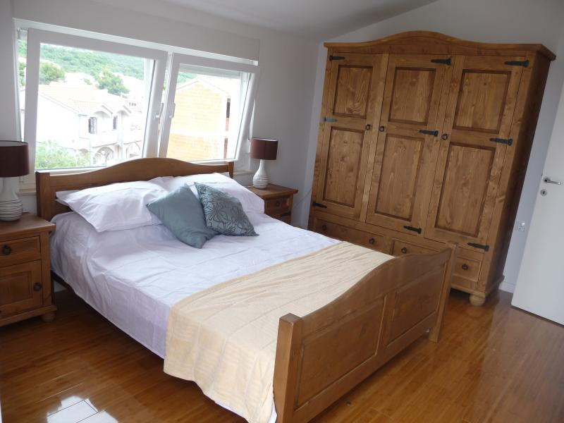 Main bedroom with king / 5ft bed and large Mexican pine wardrobe
