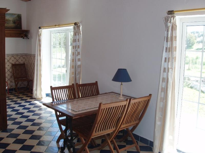 A portion of the Guesthouse with the dining table and patio doors, multifunctional, studio works