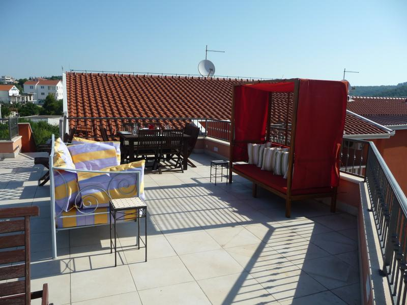 The large stunning roof terrace - summer 2012. Please note red canopied bench damaged and removed.