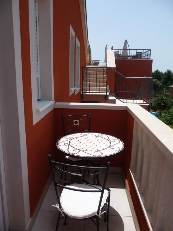 Balcony off main bedroom with table & 2 chairs - perfect for enjoying the afternoon sun!