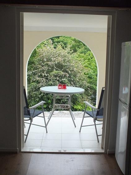 Showing the all weather covered patio that leads directly from the kitchen through two french doors