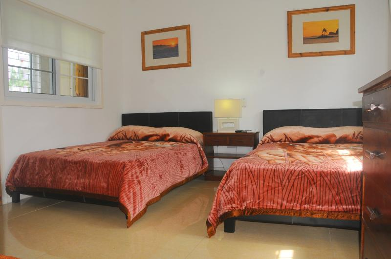 Bedroom number 2  Features WIFI/Air Con/Cable TV. Personal Bathroom with Shower/Safe.