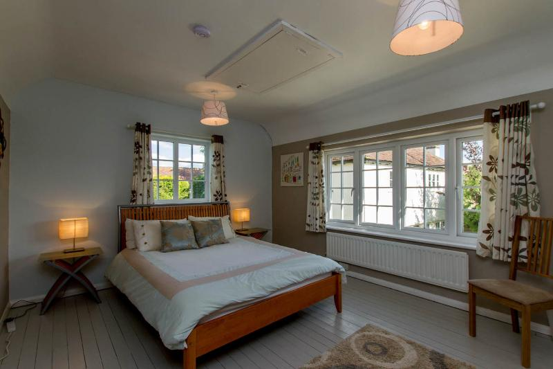 The spacious and light master bedroom with views to open fields