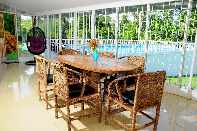 Quality pool side lounge area with seating for 10 people with spectacular views of fruited gardens.