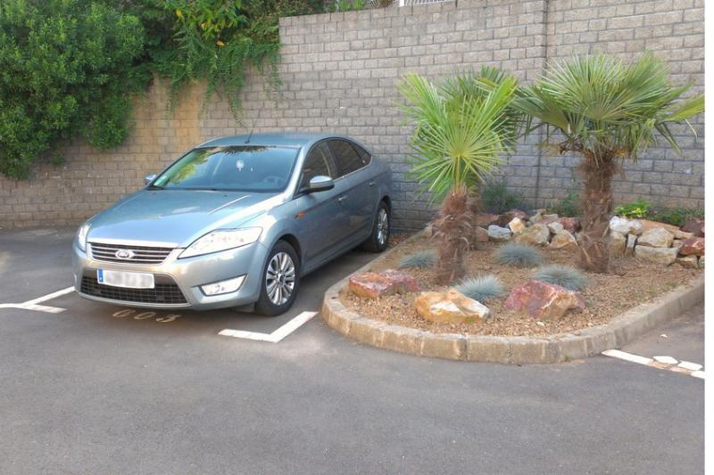 Secure parking space within the gated development