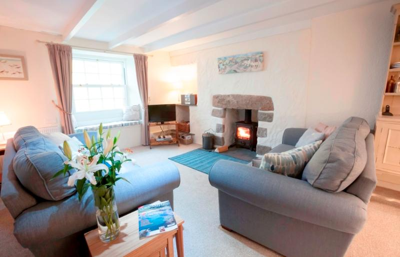 Sumptuous sofas, a granite fireplace & log burner (freeview TV/Dvd & free Wi-Fi too).