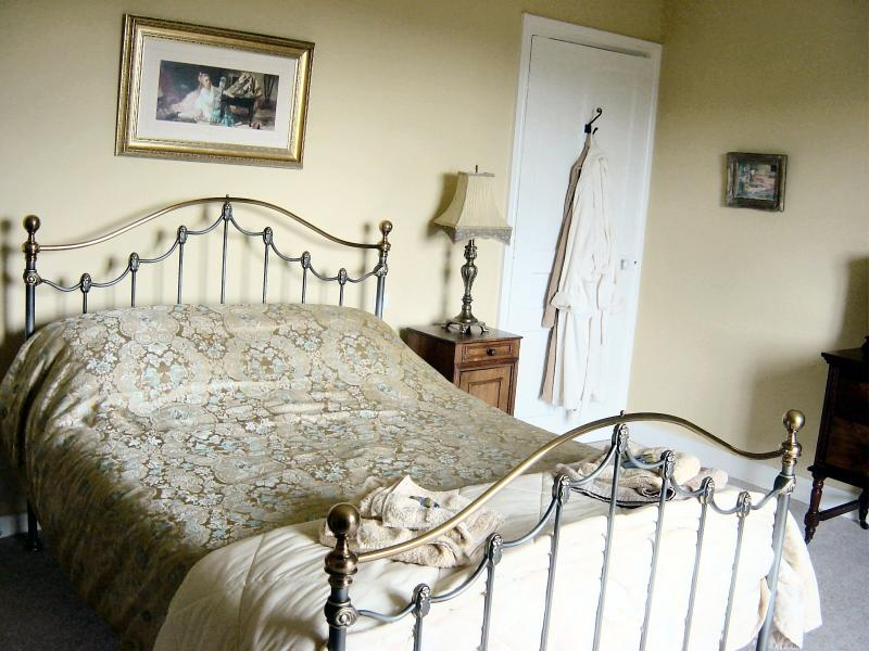 Master bedroom with magnificent wrought iron balcony with table and chairs to relax on & enjoy v