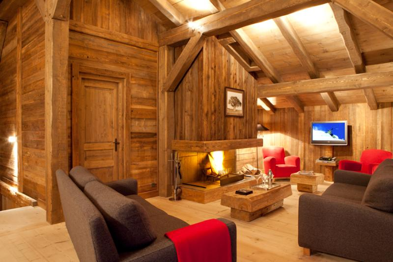 Relax in Comfort in front of the log fire in the spacious lounge, with majestic mountain views