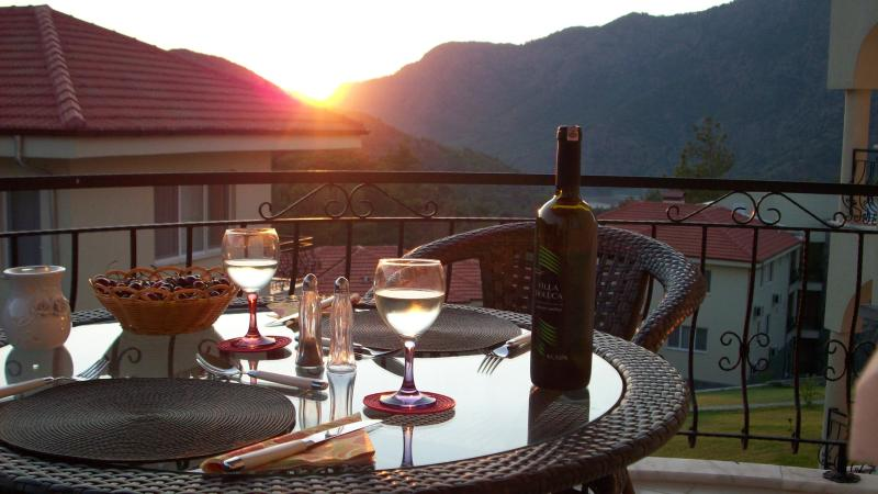 Dine al fresco overlooking the lake and mountain