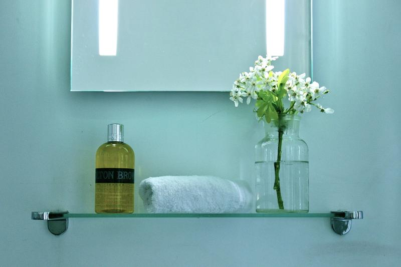 Molton Brown shower gel and flowers from the garden with sensor mirror