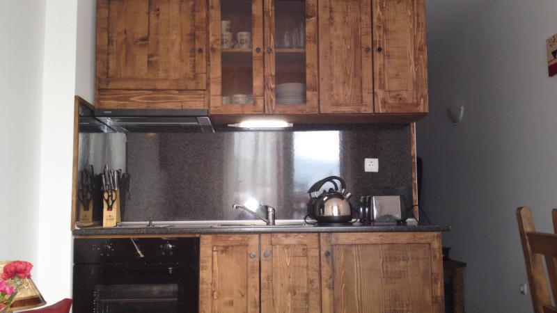 Kitchen with cooker hob fridge