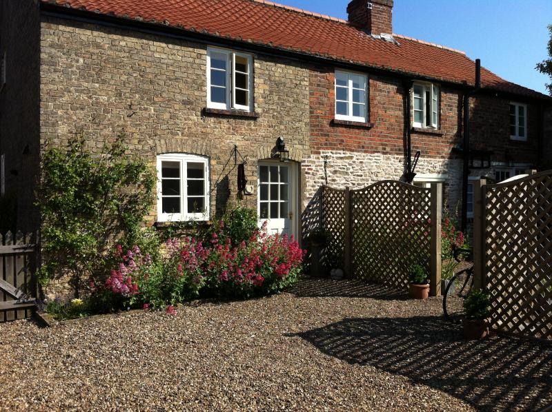 The south facing sunny exterior to Horseshoe cottage, sunny walled courtyard; BBQ and eating area