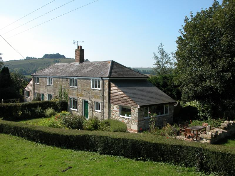 Both cottages and gardens each sleep 6. stunning views towards the South Wessex Downs.