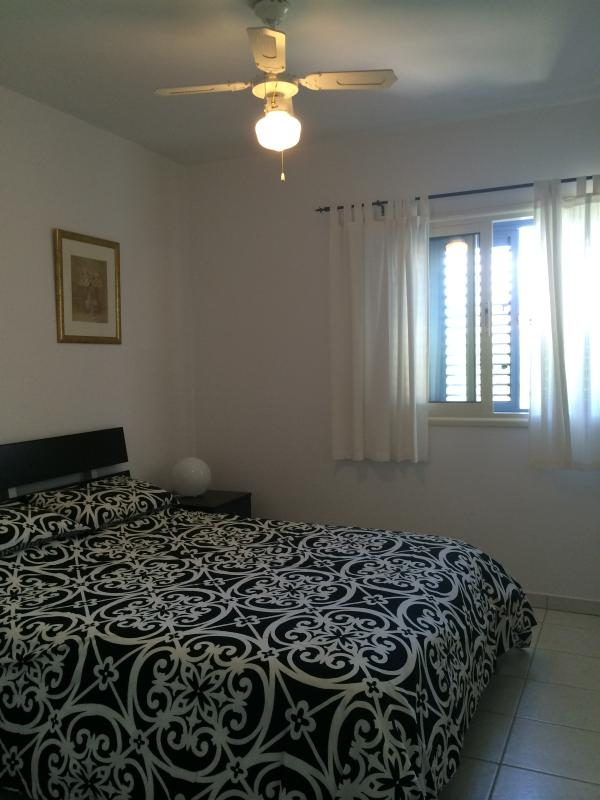 main bedroom with ensuite and air con/ceiling fan/floor fan plus fully fitted wardrobes