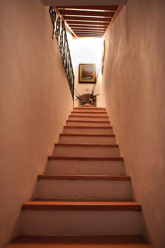 Inside, you climb the staircase leading to the living