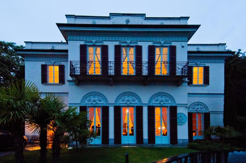 Villa Lucia as the sun sets across Lake Como