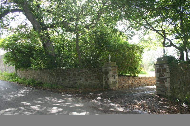 Quiet leafy lane and entrance to property