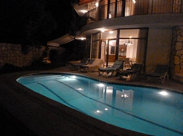 villa poolside at night