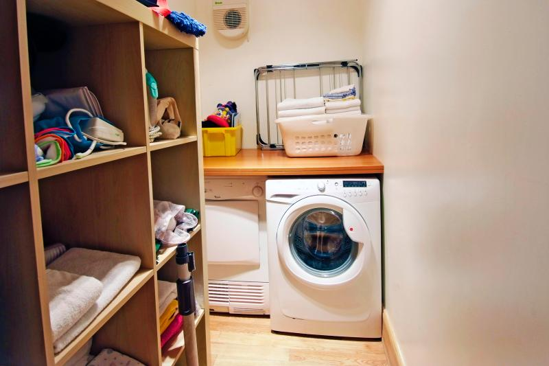 Utility room - washing machine and separate condenser dryer