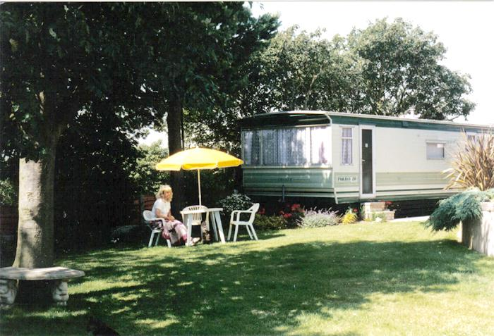 View of caravan from the garden and lawn