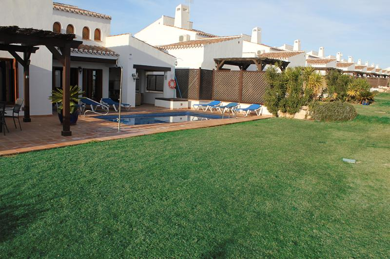 Southerly facing  Private Pool and grass-patio area