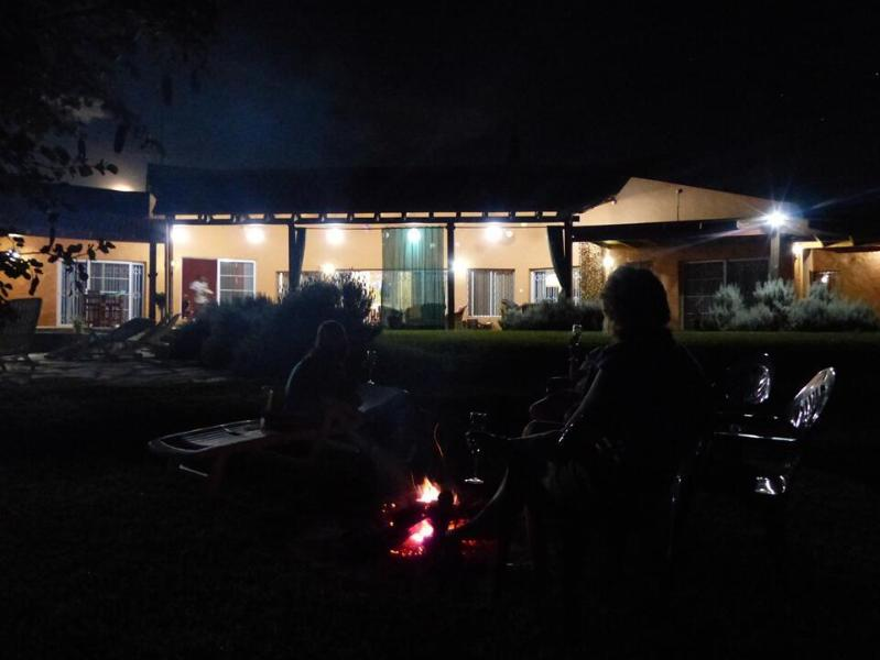 Enjoy burning embers and the stars while gathered around the fire pit.