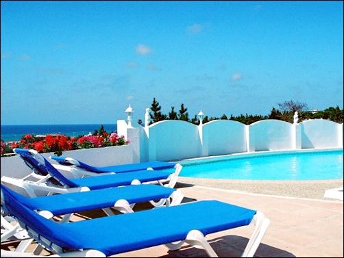 Comfortable lounging around the private pool with the sea view over the balcony