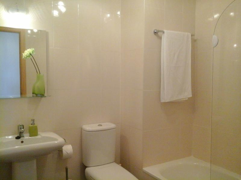 En suite bathroom with bathtub and shower.