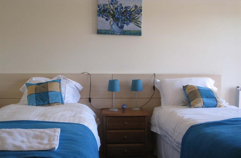 Twin bedroom en-suite and balcony - first floor (single/double beds)