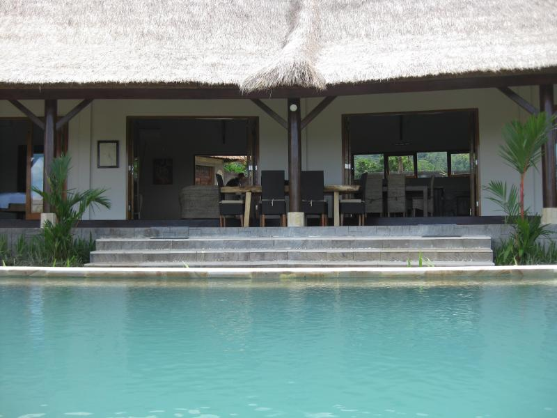 Private pool is overlooked by villas broad verandah