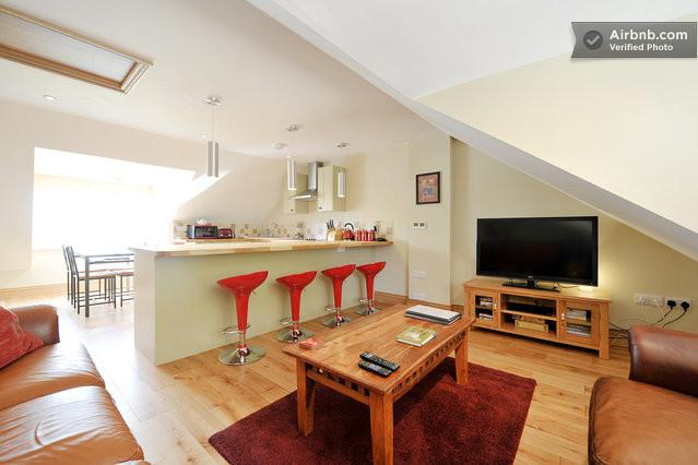 A stylish blend of traditional and modern. There's a large dining table and breakfast bar