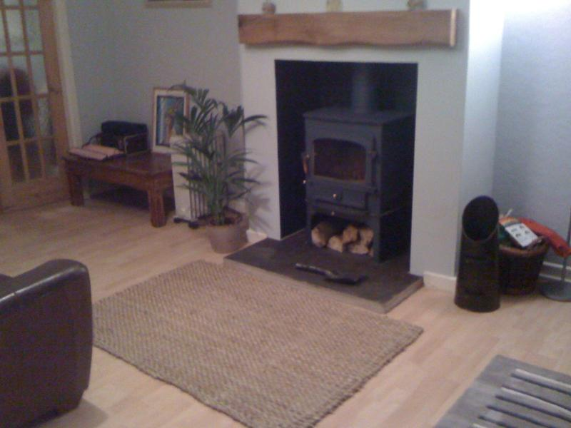 Cosy evenings with our new log burner and thermostatically controlled heating