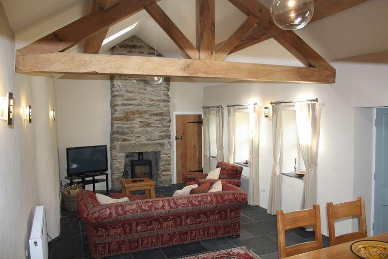 Living Area with Oak Beams and Log Burner