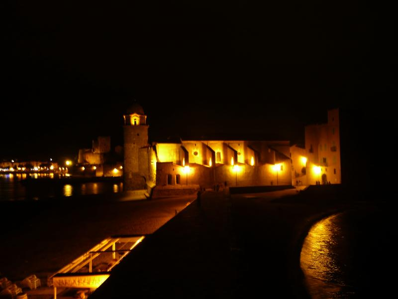 the housse and 'ND des Anges' in the night