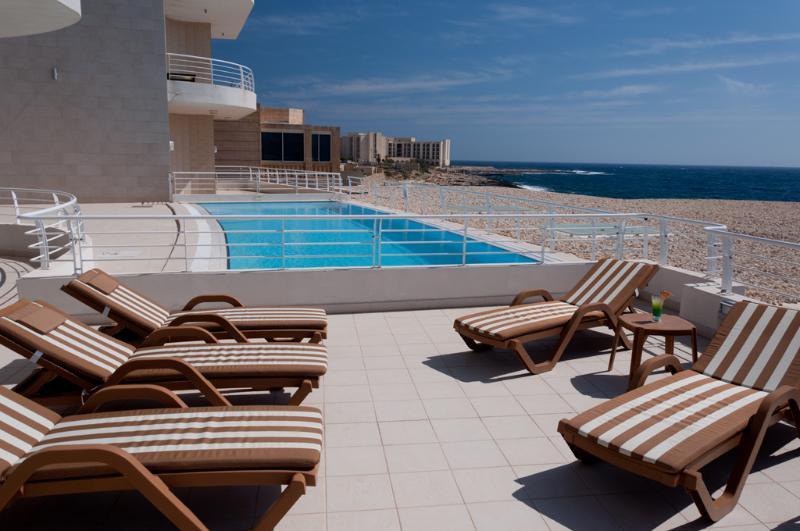 Property Private Terrace showing communal Pool