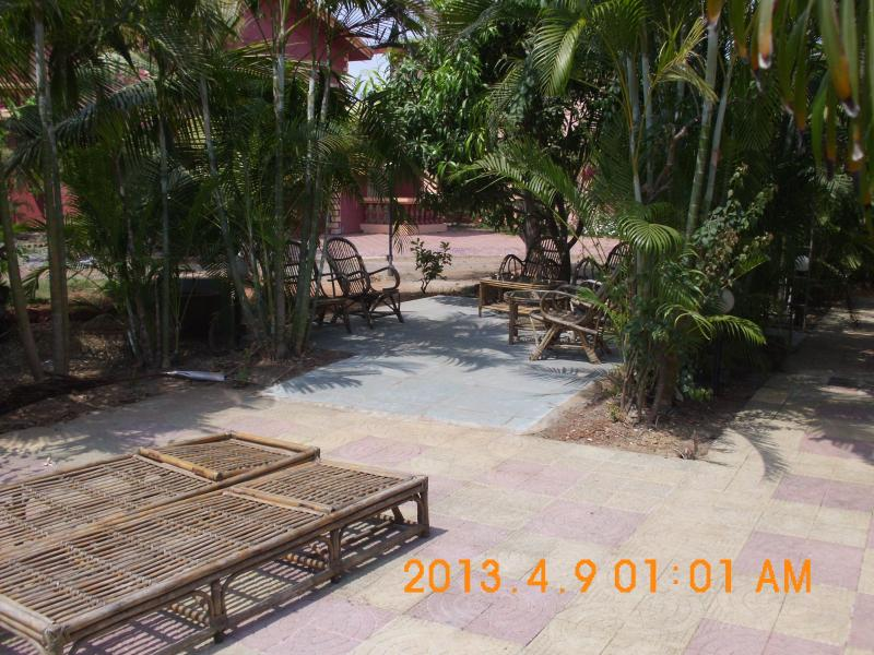 Large shaded Patio with Garden Cane Furniture
