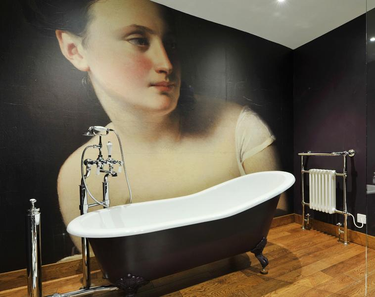 Feature  bathroom with roll top cast iron bath, walk in shower and beautiful wall mural!