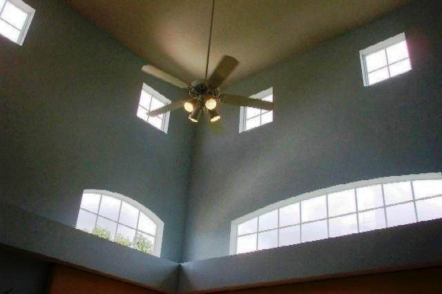 Tall vaulted ceilings keep the house cool
