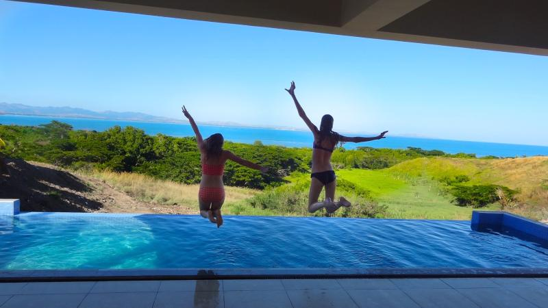 Jumping into the infinity pool from the villa main pool deck!  What a view!