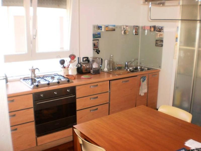 fully equipped kitchen with dishwasher, fridge and microwave